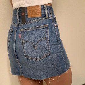 Levi's Skirts - Levi's premium high rise raw hem denim mini skirt